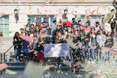 Group shot of CPCC students with confetti falling